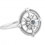 silver ring with compass design and blue gem